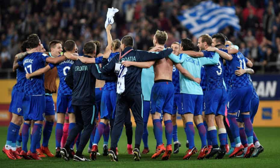 Croatia's players celebrate after winning their way through to the World Cup finals in 2018 with a 0-0 draw against Greece in Piraeus on Sunday.