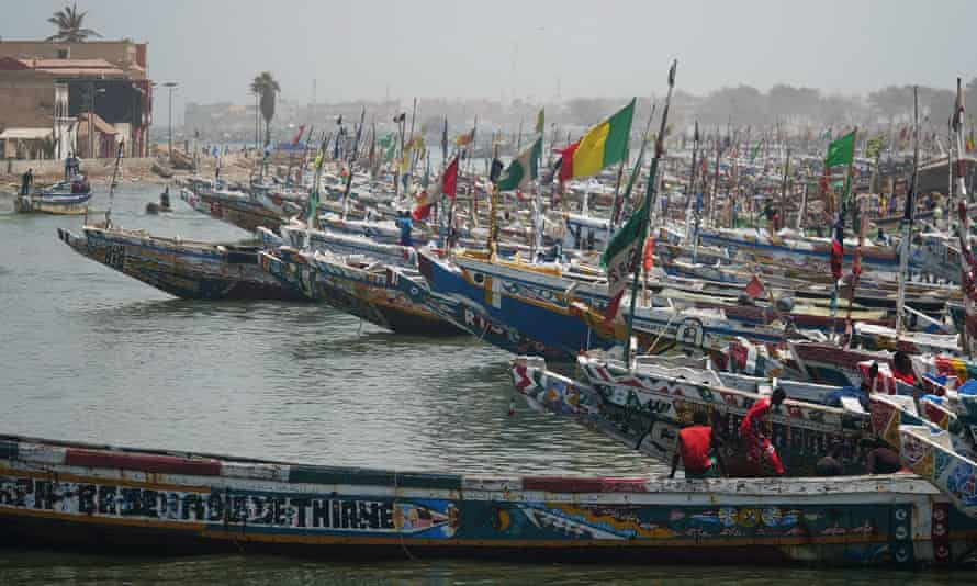 Fishing boats are seen while fishermen prepare for fishing