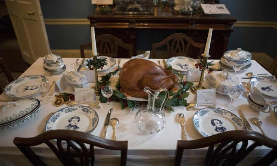 The Dickens house dining room table decorated for Christmas.