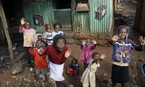Children cheer and wave in Kangemi during Pope Francis visit