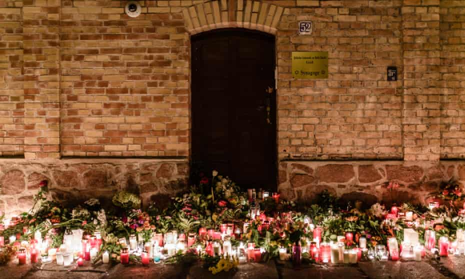 Candles and flowers are laid in front of the synagogue in Halle after the attack last year