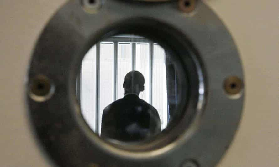 A security guard at the Colnbrook immigration removal centre near London's Heathrow Airport