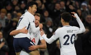 Harry Kane celebrates scoring Tottenham's third goal against Stoke with team mates.