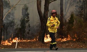 A firefighter works to contain a small bushfire on the NSW south coast. Federal Labor MP Mike Kelly says volunteer personnel is stretched and a civil defence corps is needed as part of a national disaster response reserve.