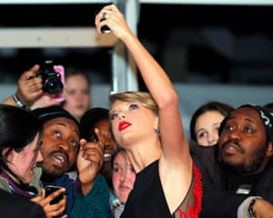 Taylor Swift poses for selfies with fans