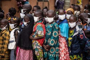 Ouagadougou, Burkina FasoPupils wearing face masks wait for the opening of their primary school on the first day of the new school year