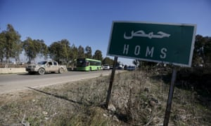 Buses leaving al-Waer under the terms of the ceasefire.
