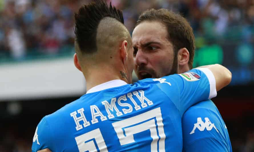 Napoli's Gonzalo Higuaín celebrates with his team-mate Marek Hamsik after scoring against Fiorentina in their Serie A match.