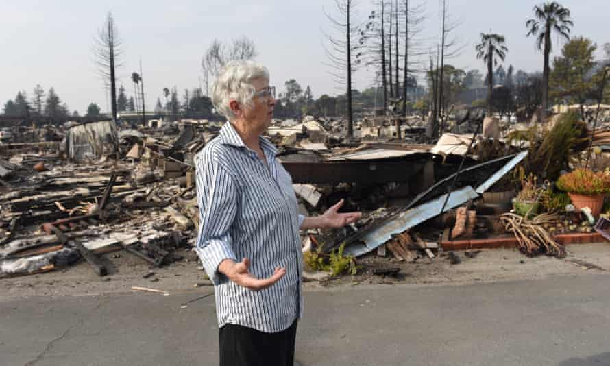 Joyannah Lonnes collects a few last items from her ruined mobile home.