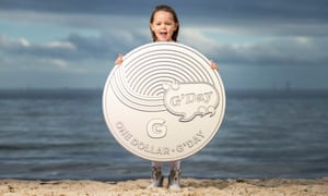 Girl holds an Australia Post G'Day coin mockup