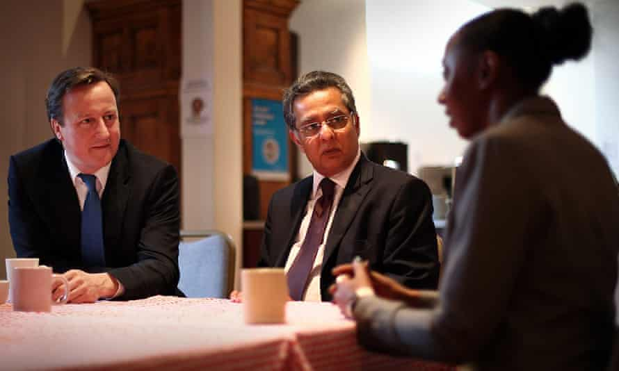 Ravi Govindia, centre, with David Cameron and a Wandsworth resident.