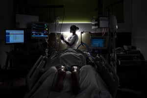 A nurse takes care of a patient infected with Covid-19, in the intensive care unit of Lyon-Sud hospital in Pierre-Benite.