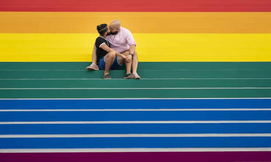couple kisses on rainbow steps in the bronx, New York