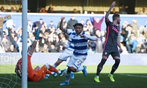 QPR's Nahki Wells celebrates scoring while Leeds' Mateusz Klich and Kiko Casilla appeal in vain for handball