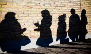 Teenage girls in shadow.