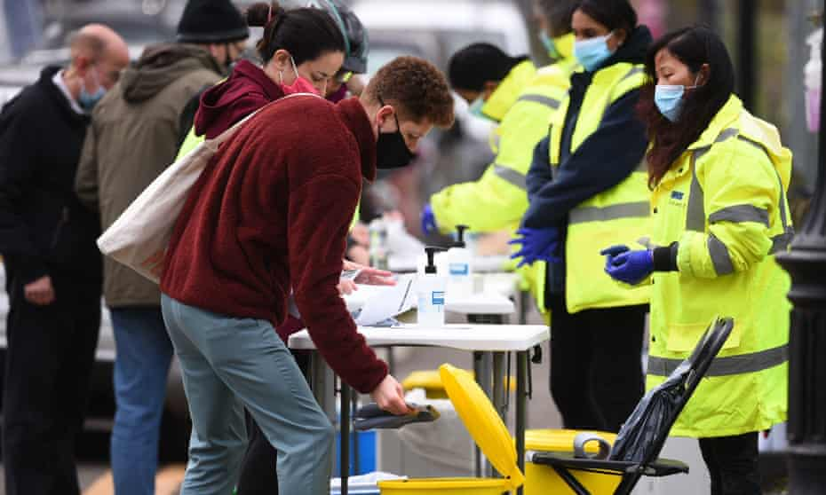 People taking part in coronavirus surge testing on Clapham Common in Wandsworth, south London.