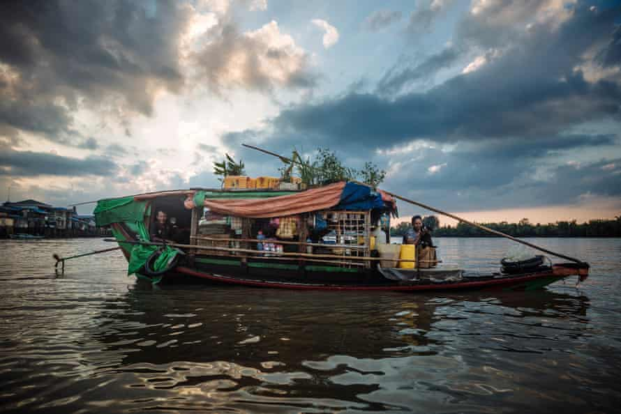 Tin and Naing win live on a small boat which they travel throughout the Delta region in Myanmar.