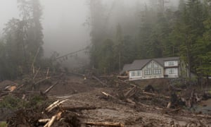 Heavy rain causes a landslide in Sitka, Alaska, on 18 August 2015, sending shattered trees crashing past a house and burying another new home, leaving four people missing, news reports said.