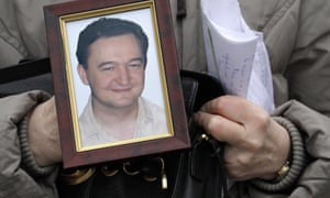 A portrait of the lawyer Sergei Magnitsky, held by his mother