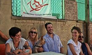 Members of the grassroots movement Assemblea Sociale per la Casa, including its co-founder, Nicola Ussardi (centre).