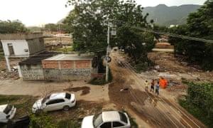 People stand in the mostly demolished Vila Autodromo favela community