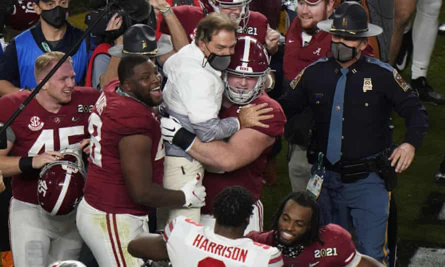 Players celebrate with Alabama head coach Nick Saban after their win against Ohio State