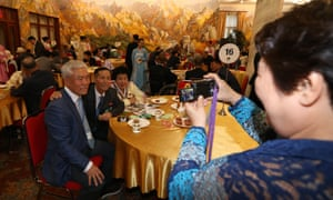 South Korean Kim Young-seok (L), 78, meets his North Korean relatives during a separated family reunion