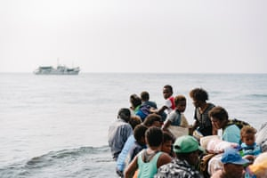 A small banana boat carries its first group of evacuees away from Ambae Island towards a ship that will travel to Espiritu Santo, Vanuatu's largest island, on a four-hour ship journey. Ambae residents returned to Ambae in October 2017, just one month after the previous mandatory evacuation. Within months, volanco activity resumed.