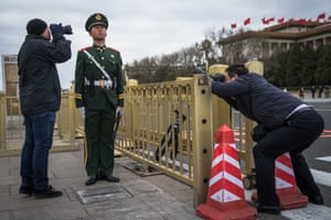 Beijing, China People take photos of a People's Liberation Army soldier