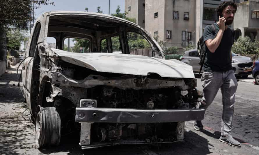 A torched vehicle in the city of Lod, Israel.