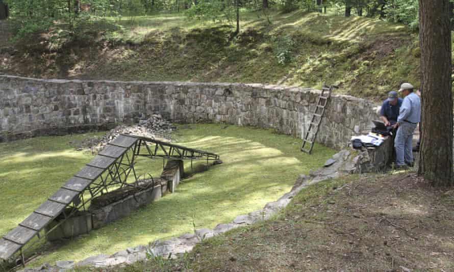 Researchers at the Ponar massacre site near Vilnius
