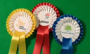Rosettes for the three main UK political parties.
