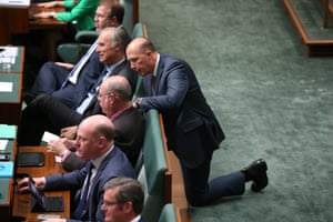Immigration minister Peter Dutton talks with Warren Entsch during question time.