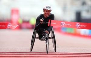 Manuela Schar of Switzerland crosses the line to win the women's elite wheelchair race