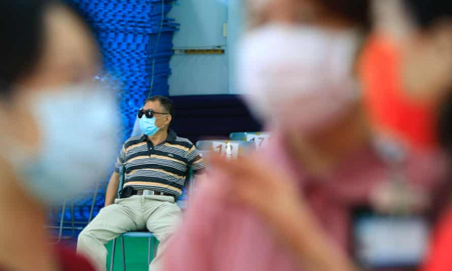 People wait for Covid vaccines in Taiwan
