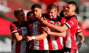Che Adams is mobbed by teammates after scoring a glorious winner