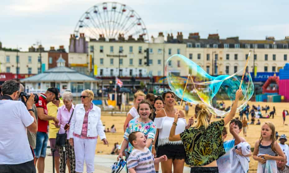 Blowing Bubbles on the promenade at Margate seaside, Kent,