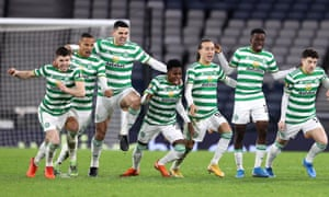 Celtic's players celebrate after the decisive penalty in the shootout.