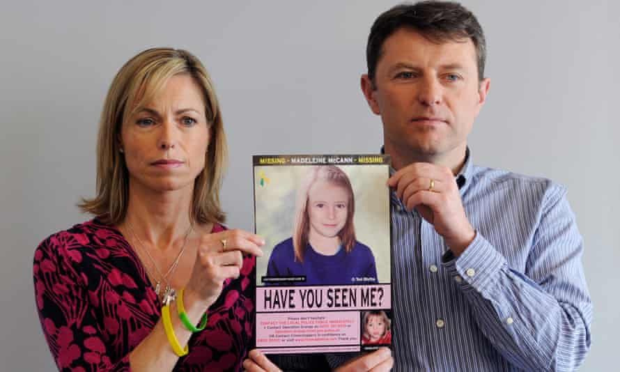 Kate and Gerry McCann hold an age-progressed police image of their daughter Madeleine during a news conference in 2012.