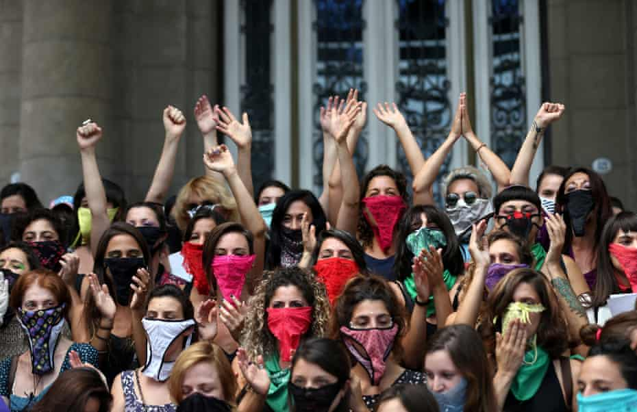Women wear knickers as masks during a demonstration on International Women's Day in Buenos Aires, Argentina
