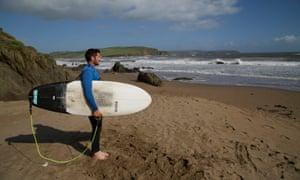 Chemistry teacher Rich Thomson in winter wetsuit on beach