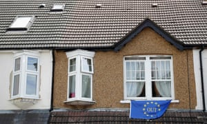A pro-Brexit flag is attached to a window of a house in Carshalton, south of London.