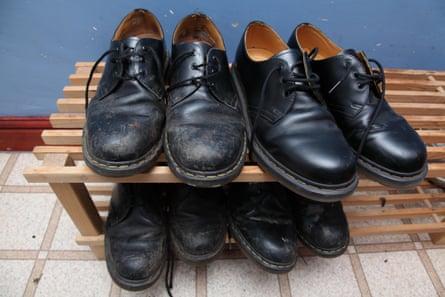 Four pairs of black Fr Marten shoes