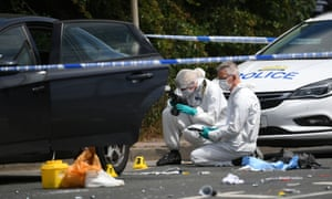 Forensic officers at the scene of the shooting in Roydon, Harlow, on Saturday.