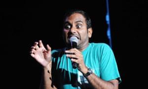 Aziz Ansari performing on stage.