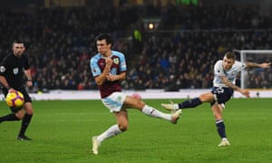 Lucas Digne (right) of Everton shoots past Burnley's Jack Cork to register his team's fourth in the comfortable win at Turf Moor.