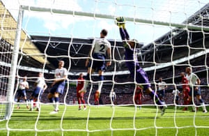 Georginio Wijnaldum scores Liverpool's first after technology adjudged his header to have crossed the line despite the attempts of Spurs keeper Michel Vorm to clear. Wijnaldum's opener was the 19th Premier League goal of his career but the first to come in an away game.