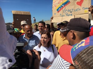 Maria Belandria, the Venezuelan opposition's ambassador to Brazil, addresses crowds at the Brazil-Venezuela border
