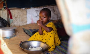 A child at Misan camp for displaced people, on the outskirts of Mogadishu. The UN says half the population of Somalia are facing acute food insecurity