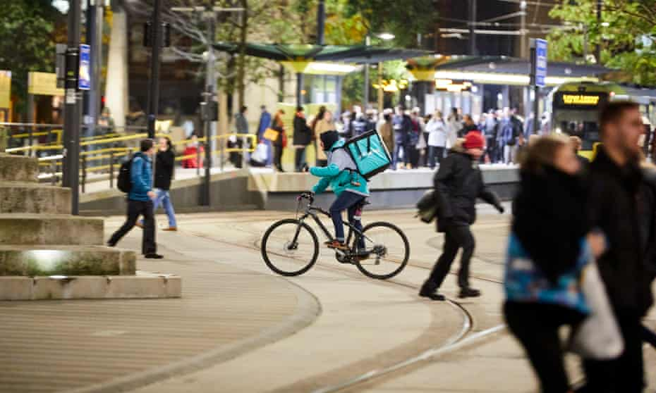 A Deliveroo courier in Manchester.